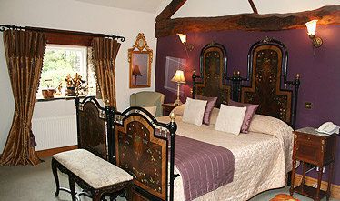an image showing one of their double bedrooms at their country house hotel