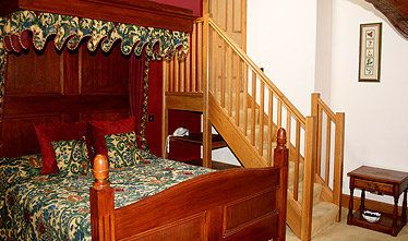 an image showing one of their double bedrooms with staircase